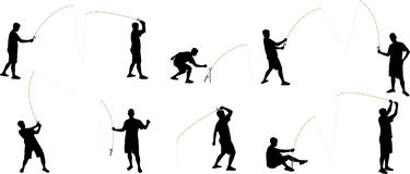 Siluetas de la pesca imagen de archivo