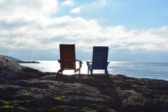 Siluetas de la silla de playa Imagen de archivo