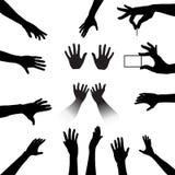 Siluetas de las manos de la gente fijadas Fotos de archivo
