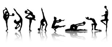 Siluetas de las muchachas del gimnasta Imágenes de archivo libres de regalías