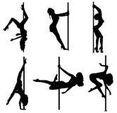 Siluetas de las mujeres de la danza de poste Foto de archivo