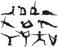Siluetas de las posiciones de la yoga respecto al fondo blanco Foto de archivo