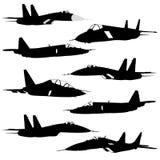 Siluetas de los aviones de combate Imagen de archivo