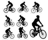 Siluetas de los ciclistas fijadas Foto de archivo libre de regalías