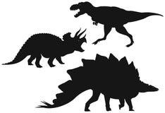 Siluetas de los dinosaurios Foto de archivo libre de regalías