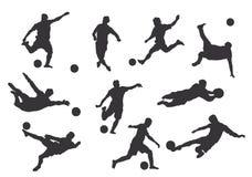 Siluetas de los futbolistas Imagenes de archivo