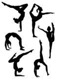 Siluetas de los gimnastas de las muchachas Fotografía de archivo