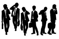 Siluetas de los hombres de negocios que hablan el teléfono ilustración del vector