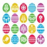 Siluetas de los huevos de Pascua del color aislados en el fondo blanco Huevos de Pascua del día de fiesta adornados con las flore stock de ilustración