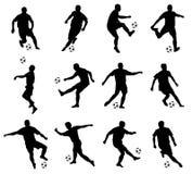Siluetas de los jugadores de fútbol Imagenes de archivo