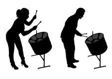 Siluetas de los jugadores del tambor de acero Fotografía de archivo