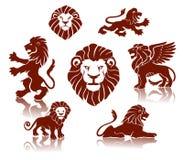 Siluetas de los leones fijadas Imagenes de archivo