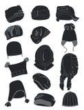 Siluetas de los sombreros del invierno Imagen de archivo libre de regalías