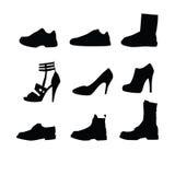 Siluetas de los zapatos de los hombres y de las mujeres Fotografía de archivo libre de regalías