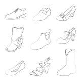 Siluetas de los zapatos de los hombres y de las mujeres Fotos de archivo libres de regalías