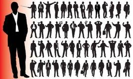 Siluetas de muchos hombres de negocios Fotografía de archivo libre de regalías