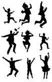 Siluetas de salto con la expresión de la felicidad Fotos de archivo