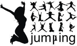 Siluetas de salto de la gente Foto de archivo libre de regalías
