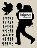 Siluetas del Backpacker Imagenes de archivo