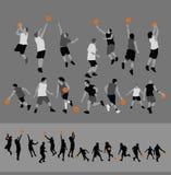 Siluetas del baloncesto Imagenes de archivo