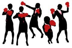 Siluetas del boxeo de la mujer de negocios Imagenes de archivo