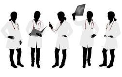Siluetas del doctor de sexo femenino Fotos de archivo libres de regalías