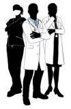 Siluetas del doctor del equipo médico Fotografía de archivo libre de regalías
