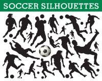 Siluetas del fútbol Fotografía de archivo libre de regalías