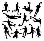 Siluetas del futbolista del fútbol Fotos de archivo libres de regalías