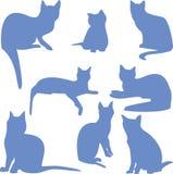 Siluetas del gatos que se sientan azules Fotos de archivo