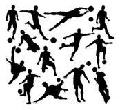 Siluetas del jugador de fútbol del fútbol Foto de archivo