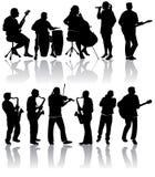 Siluetas del músico Fotografía de archivo libre de regalías