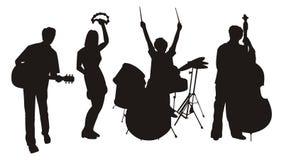 Siluetas del músico Imagen de archivo libre de regalías