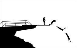 Siluetas del salto Foto de archivo libre de regalías