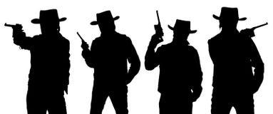 Siluetas del vaquero con un arma en un sombrero de alas anchas Imágenes de archivo libres de regalías