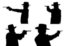 Siluetas del vaquero con una pistola Imagen de archivo libre de regalías