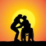Siluetas del vector de la gente en una silla de ruedas Fotos de archivo