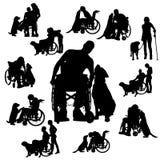 Siluetas del vector de la gente en una silla de ruedas Fotos de archivo libres de regalías
