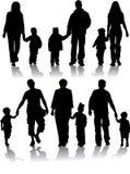 Siluetas del vector de padres con los niños Imagen de archivo libre de regalías