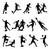 Siluetas del vector del jugador de fútbol Imagen de archivo libre de regalías
