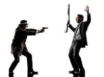 Siluetas detectives de las investigaciones de criminales del hombre Imagen de archivo libre de regalías