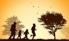 Siluetas felices de la familia Imagenes de archivo