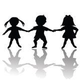 Siluetas felices de los niños Imagen de archivo libre de regalías