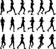 siluetas femeninas de los corredores de maratón Imagenes de archivo