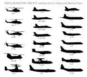 Siluetas modernas de los aviones militares Foto de archivo libre de regalías