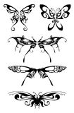 Siluetas negras de la mariposa Fotos de archivo