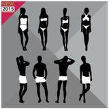 Siluetas negras de los hombres de las mujeres del traje del verano de los trajes de baño de la ropa de playa/del traje de baño, s Fotografía de archivo libre de regalías