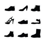 Siluetas negras de los zapatos Fotografía de archivo