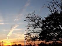 Siluetas y puestas del sol Imágenes de archivo libres de regalías