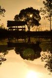 Siluetea la choza en piscina de la granja Fotografía de archivo libre de regalías